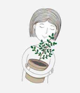 植物を大切に守る女性