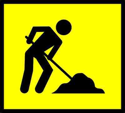 人間が土を掘る看板