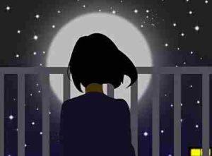 夜空と寂しい女性